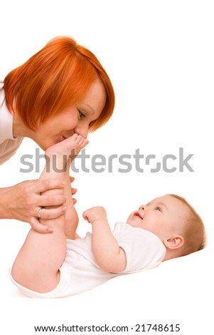 Young mother with cute little daughter. Isolated over white