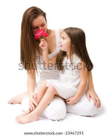 Young mother with cute little daughter. Isolated over white - stock photo