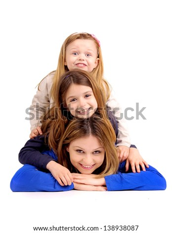 young mother with daughters isolated in white