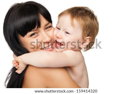 Young mother with her baby after bathing in a white towel - stock photo