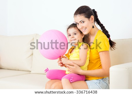 young mother with her baby on the couch