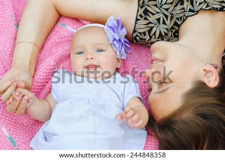 Young mother with her little daughter. - stock photo