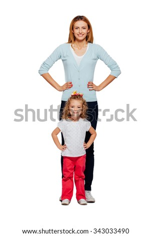 young mother with her little daughter isolated on white