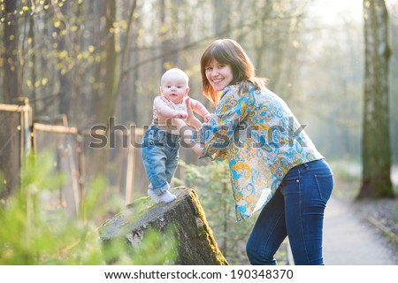 Young mother with her little son in a spring forest - stock photo