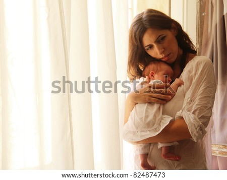 young mother with her newborn baby - stock photo