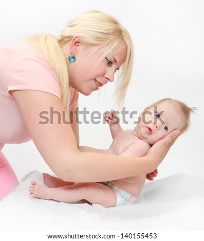 Young mother with her newborn baby boy together.