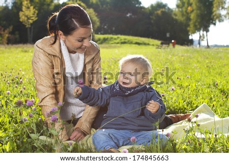 Young mother with her young child having a good time
