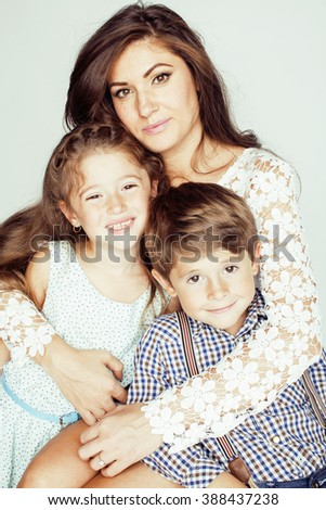 young mother with two children on white, happy smiling family inside - stock photo