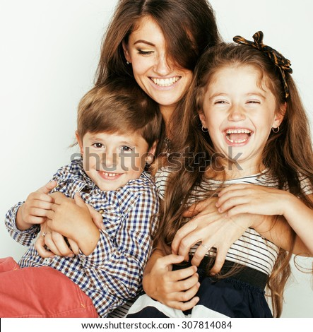 young mother with two children on white, happy smiling family inside close up - stock photo