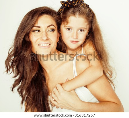 young mother with two children on white, happy smiling family inside close up