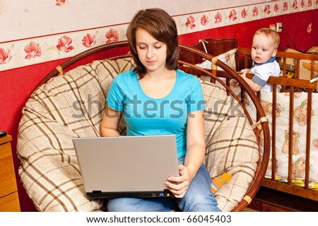 Young mother works at home - stock photo