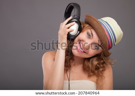 Young motion woman with headphones listening music .Music teenager girl. Beautiful female model.