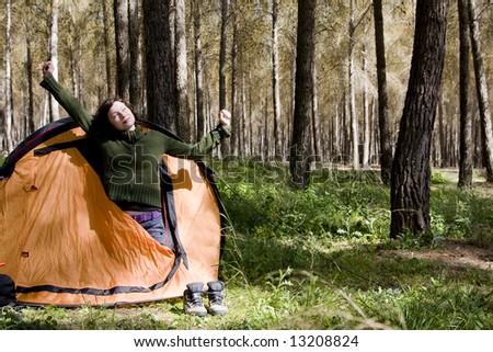 Young mountaineer waking up in the morning - stock photo