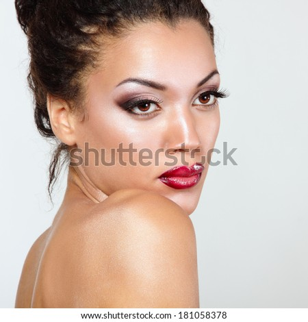 Young mulatto fresh woman with beautiful makeup, isolated - stock photo