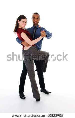 young multi ethnic couple beautiful dancing on white