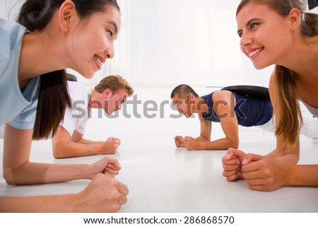 Young multi ethnic people exercising in gym - stock photo