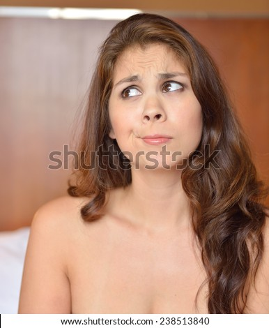 Young multi-racial/biracial woman looking confused or in thought - expression series - stock photo
