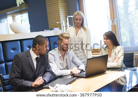 Young multiethnic people working in the office