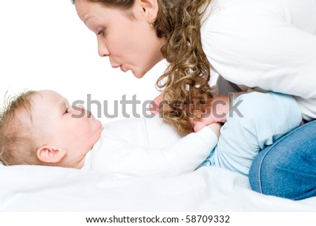 Young mum and daughter on a white background