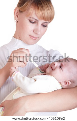 Young mum measures temperature at the child