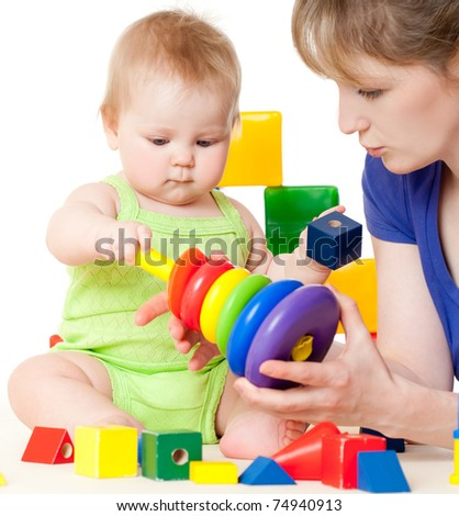 Young mummy and her kid on a white background - stock photo