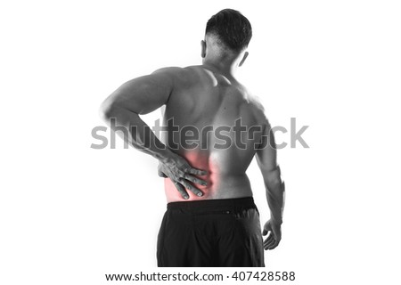 young muscular body sport man holding sore low back waist with hand  suffering pain in athlete stress and health care concept isolated black and  white red spot injury - stock photo