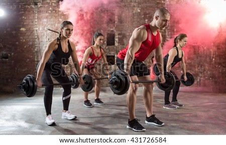 young muscular bodybuilders workout torso with dumbbell - stock photo