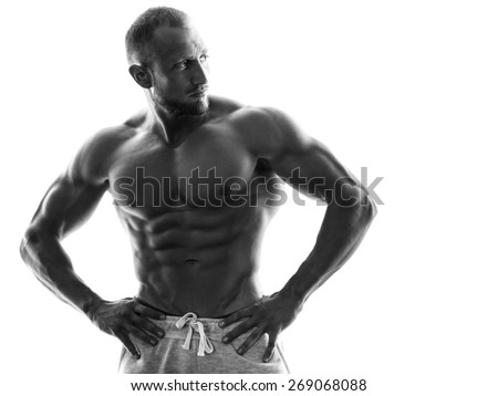 Young muscular guy with sexy body on white background - stock photo