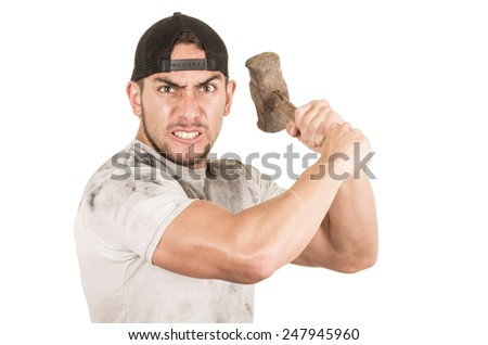 young muscular latin construction worker holding old hammer isolated on white