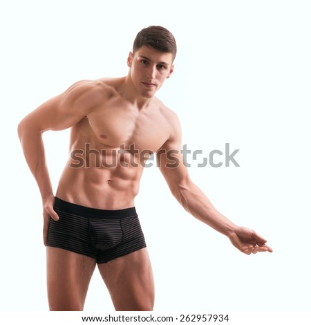 Young muscular male torso on white - stock photo