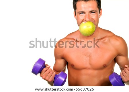 Young muscular man doing fitness and eating an apple - stock photo