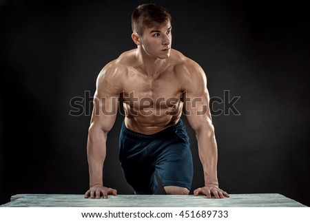 Young Muscular man flipping box
