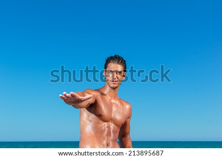 YOung muscular man on the beach