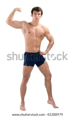Young muscular man posing isolated on white - stock photo