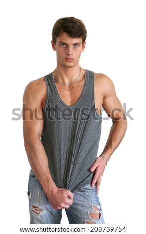 Young muscular man wearing a sleeveless shirt isolated on white - stock photo