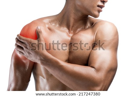 young muscular man with shoulder pain,isolated on white background with clipping path - stock photo