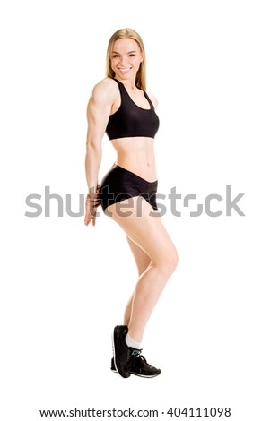 Young muscular woman posing on white background isolated - stock photo