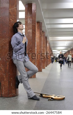 young musician at metro station - stock photo