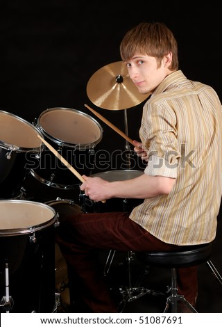 young musician beat the drums