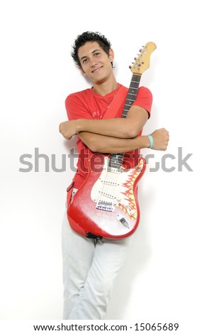 Young musician holding his electric guitar - isolated