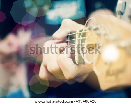 Young musician playing acoustic guitar close up. Pop art filter. - stock photo