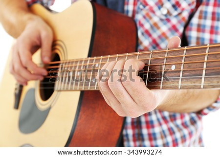 Young musician with guitar, close-up - stock photo