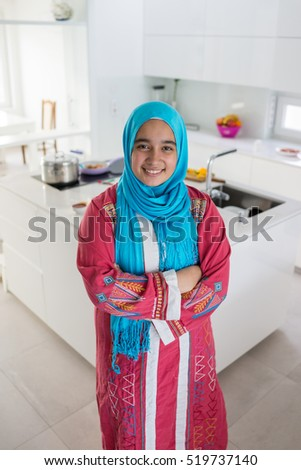 Young Muslim Arabic woman in the kitchen
