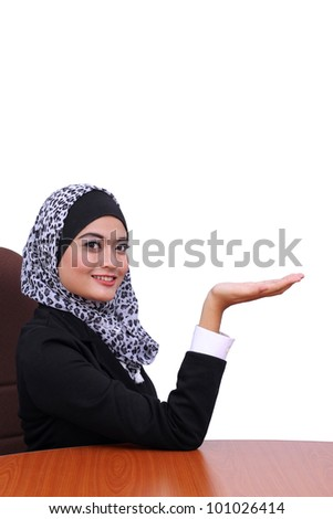 young muslim business woman showing something, isolated on white background