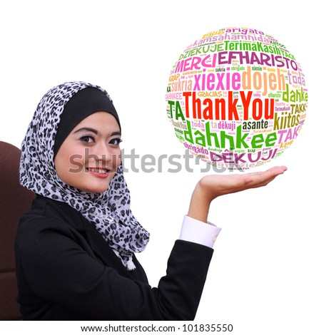 young muslim business woman showing Thank you word globe in many language, isolated on white background - stock photo