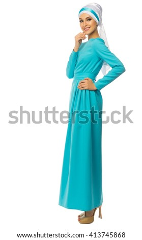 Young muslim woman in blue dress isolated - stock photo