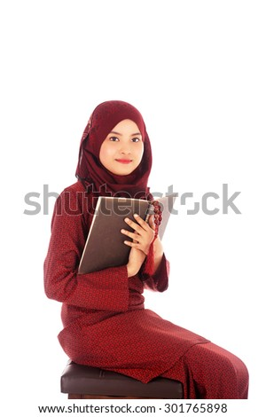 Young muslim woman read Quran with tasbih in the Ramadan time.                                - stock photo