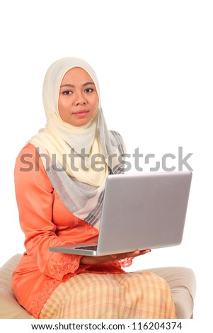 Young muslim woman with laptop