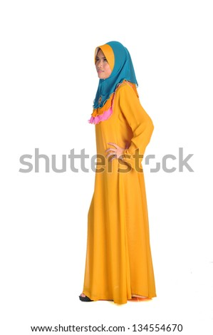Young muslim woman with long dress an isolated on white - stock photo