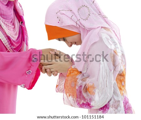 Young Muslim women greeting to elders - stock photo